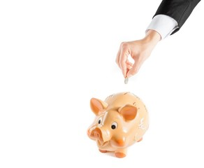 businessman inserting a coin in piggy bank, concept  save money