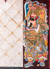 Chinese legend of the god's painting on wooden door.