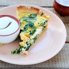 piece of quiche with salmon and spinach
