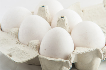 white eggs in a package to isolate the background