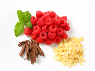 Fresh raspberries, chocolate curls and sliced almonds