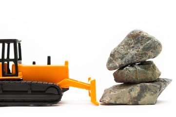 ブルドーザーが石を動かしている様子