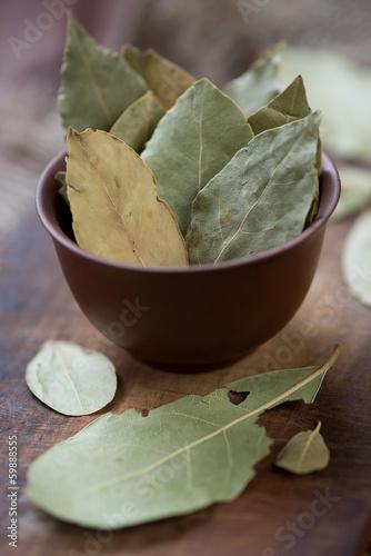Herbs: dried bay leaves, vertical shot