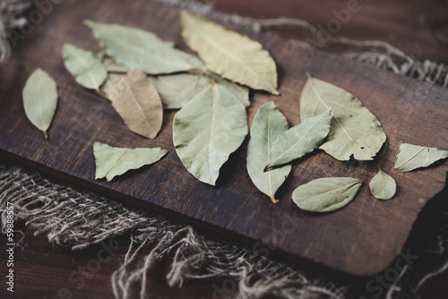 Dried bay leaves on a vintage wooden cutting board