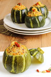 Zucchini stuffed with quinoa, vegetables and nuts
