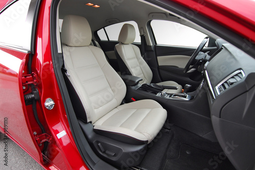Front seats of a modern car, light leather