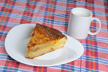 Homemade pie with cup of yogurt