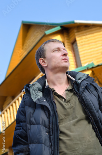 Handsome man standing thinking