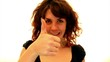 woman gives thumbs up and winks. happy day.