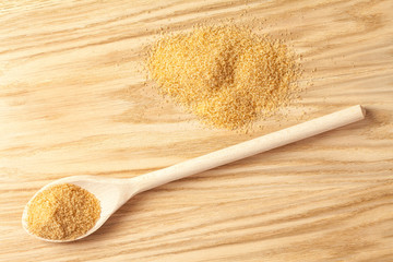 Pile of brown sugar and a spoon