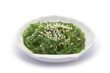 Hiyashi Wakame on shell-shaped dish isolated on white