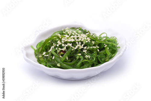 Hiyashi Wakame on shell-shaped dish isolated on white