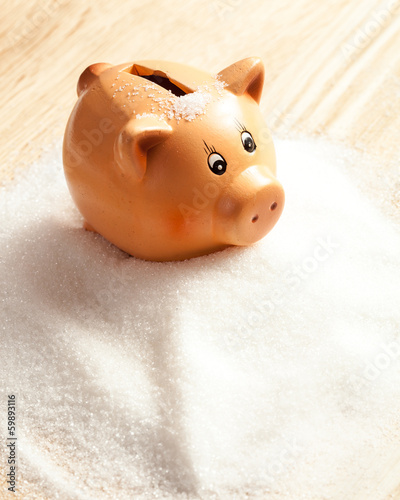 Piggy bank in a heap of sugar