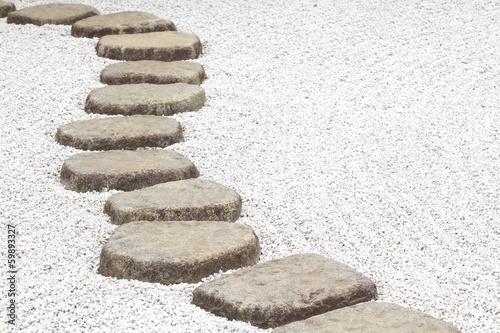 Fotobehang Tuin Zen stone path in a Japanese Garden