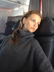 woman sleeping in plane