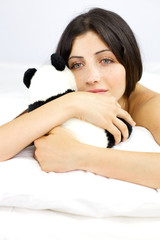 Portrait of young woman holding animal plush pensive