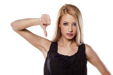 angry young woman showing thumbs down