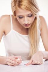 portrait of beautiful calm woman who applied nail polish