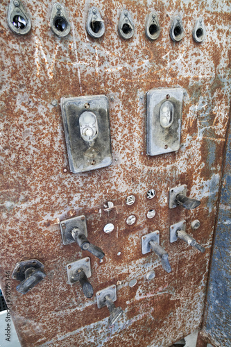 Old rusty electric transformer box with switches