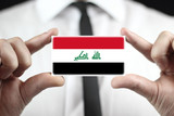 Businessman holding a business card with Iraq Flag