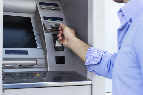 Hand of man with credit card, using a ATM - 59896391