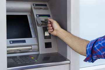 Man placed his credit card at the ATM