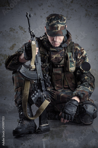 soldier sitting on the floor with arms