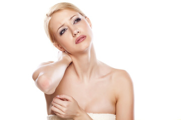 young woman with pain in her neck posing on white background