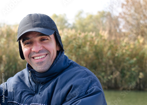 Happy man in warm clothing