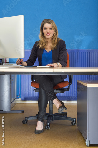 Young woman behind desk