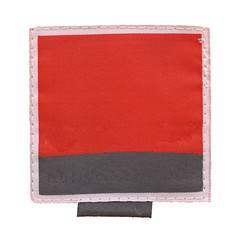 red-black textile label isolated on white