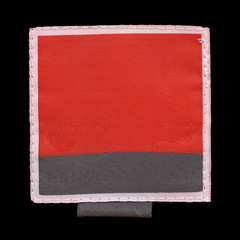 red-black textile label isolated on black