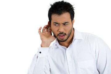 Unhappy, disgusted man listening secretly to a conversation