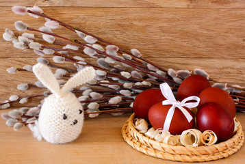 Easter eggs and rabbit on catkins background