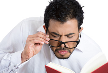 Young man trying to read, having difficulties, bad vision