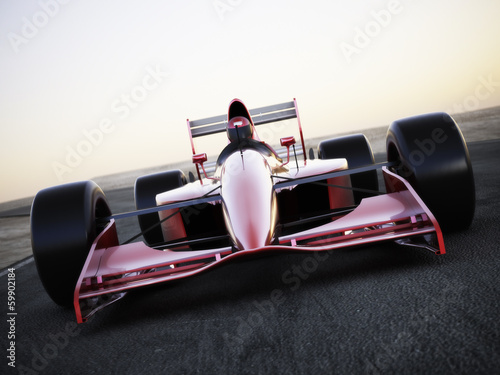Plagát, Obraz Race car racing on a track front view with motion blur