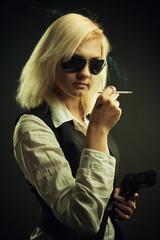 Dangerous blonde with gun