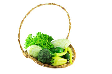 Green organic vegetables in a wicker basket