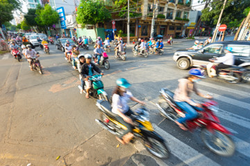 Stream of bikes in busy street in Vietnam.