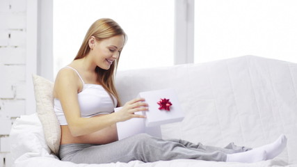 pregnant woman with gift box
