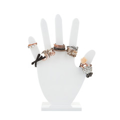 Hand-shaped jewelry holder with variety of rings isolated