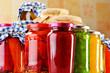 Jars of marinated food. Pickled vegetables and jams