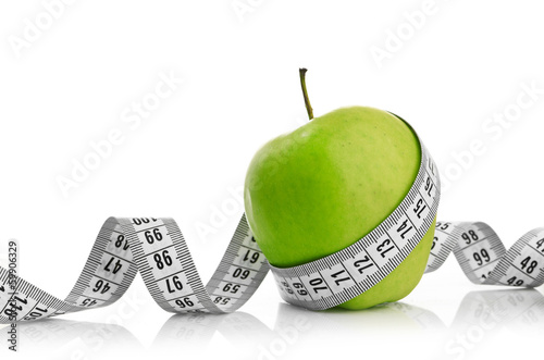 canvas print picture Measuring tape wrapped around a green apple