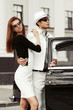 Young couple in love at the retro car