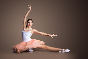Graceful slender ballerina dancing