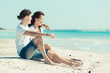 Young Couple Sitting in a Caribbean Beach
