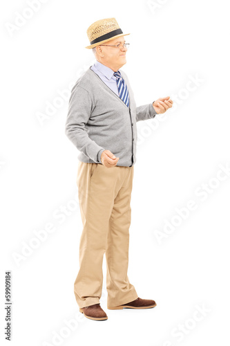 Full length portrait of senior man standing