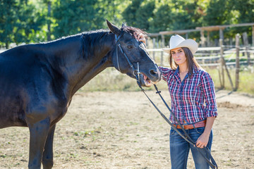 Cowgirl with a Black Stallion Horse