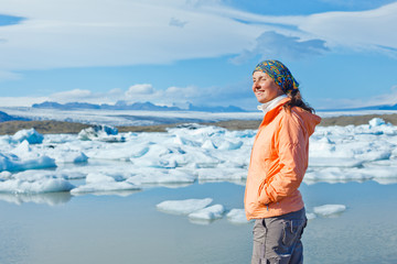 Woman watching icebergs. Iceland