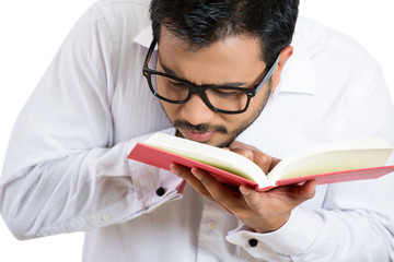Man wearing glasses having difficulty reading, bad vision